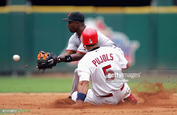 Albert Pujols of the St. Louis Cardinals beats Ray Durham of the San Francisco Giants to second base on July 24, 2004 at Busch Stadium in St. Louis,...