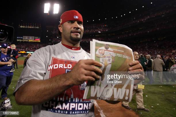 Albert Pujols of the St. Louis Cardinals celebrates after defeating the Texas Rangers 6-2 to win the World Series in Game Seven of the MLB World...