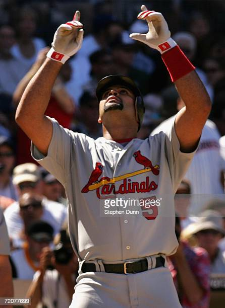 Albert Pujols of the St Louis Cardinals celebrates after hitting a 2 run home run during the fourth inning of the National League Division Series...