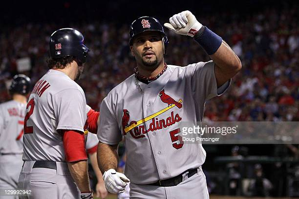 Albert Pujols of the St Louis Cardinals celebrates after hitting a threerun home run in the sixth inning during Game Three of the MLB World Series...