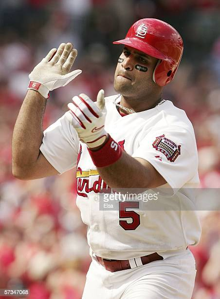 Albert Pujols of the St. Louis Cardinals celebrates his solo home run in the seventh inning against the Cincinnati Reds on April 16, 2006 at the...