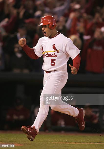 Albert Pujols of the St. Louis Cardinals celebrates while rounding the bases after Scott Rolen's 2 run home run against the Houston Astros in the...