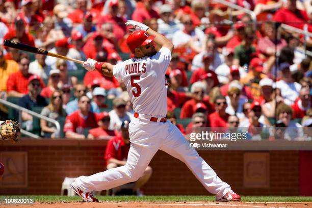 Albert Pujols of the St Louis Cardinals covers bats against the Los Angeles Angels of Anaheim at Busch Stadium on May 22 2010 in St Louis Missouri...