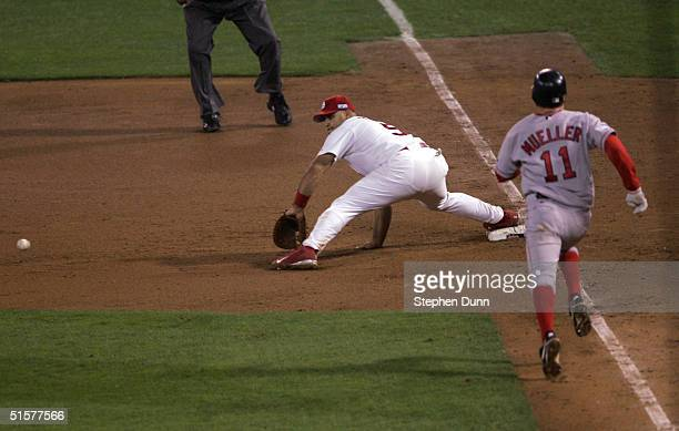 Albert Pujols of the St Louis Cardinals digs out a ground ball to complete a double play hit by Bill Mueller of the Boston Red Sox during game three...