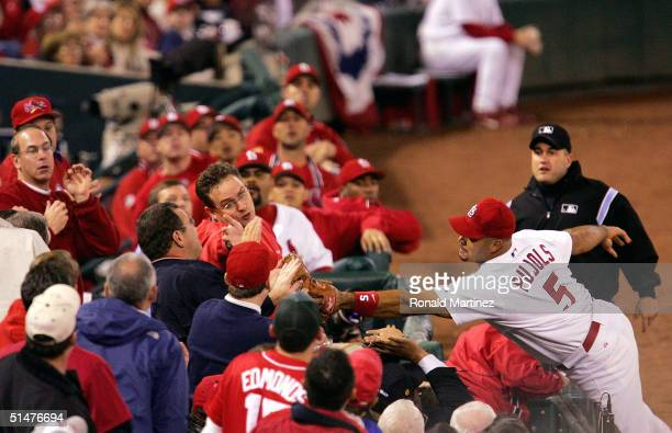 Albert Pujols of the St Louis Cardinals dives for a foul ball just out of his reach in game one of National League Championship Series against the...