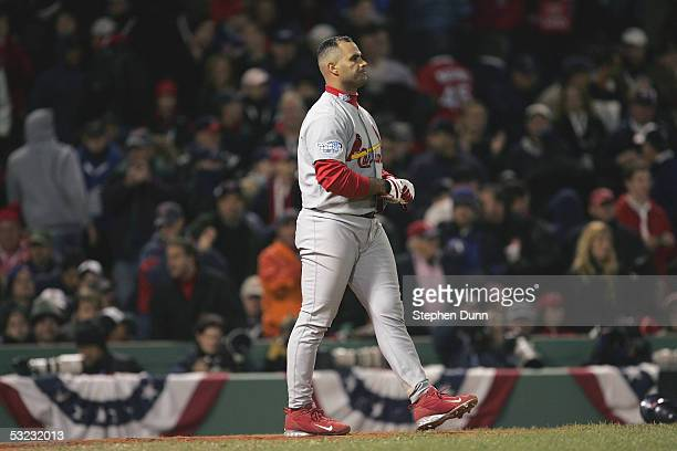 Albert Pujols of the St Louis Cardinals expresses disappointment after striking out against the Boston Red Sox during game one of the 2004 World...