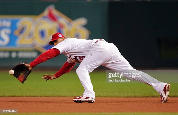 Albert Pujols of the St. Louis Cardinals fields a ball hit by Placido Polanco of the Detroit Tigers in the seventh inning during Game Five of the...