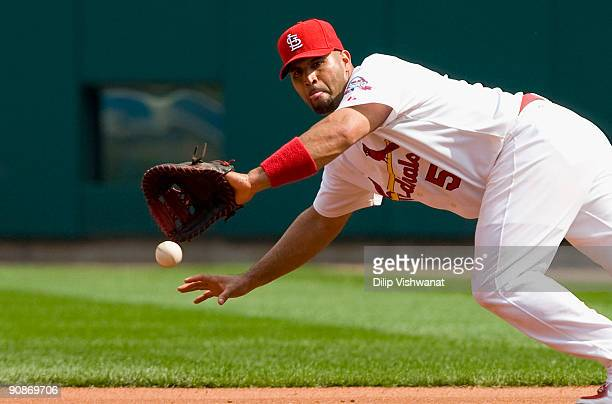 Albert Pujols of the St Louis Cardinals fields a line drive against the Florida Marlins on September 16 2009 at Busch Stadium in St Louis Missouri...