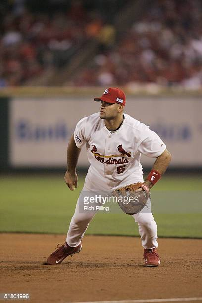 Albert Pujols of the St Louis Cardinals fields during game three of the 2004 World Series against the Boston Red Sox at Busch Stadium on October 26...