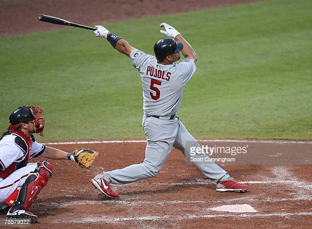 Albert Pujols of the St Louis Cardinals follows through on a 4th inning home run against the Atlanta Braves at Turner Field on July 20 2007 in...