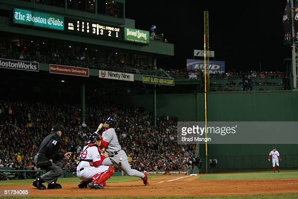 Albert Pujols of the St Louis Cardinals gets hit by a pitch during game one of the 2004 World Series against the Boston Red Sox at Fenway Park on...