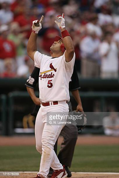 Albert Pujols of the St Louis Cardinals gives thanks after hitting a home run during a game against the Pittsburgh Pirates at Busch Stadium in St...