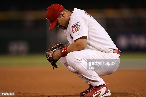 Albert Pujols of the St. Louis Cardinals hangs his head as he crouches during a pitching change against the Houston Astros during Game Six of the...