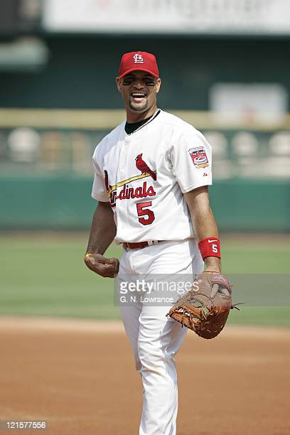 Albert Pujols of the St Louis Cardinals has a laugh during a game against the Houston Astros at Busch Stadium in St Louis Mo on July 16 2005 St Louis...