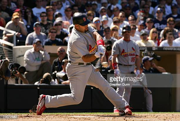 Albert Pujols of the St Louis Cardinals hits a 2 run home run during the fourth inning of the National League Division Series Game 1 against the San...