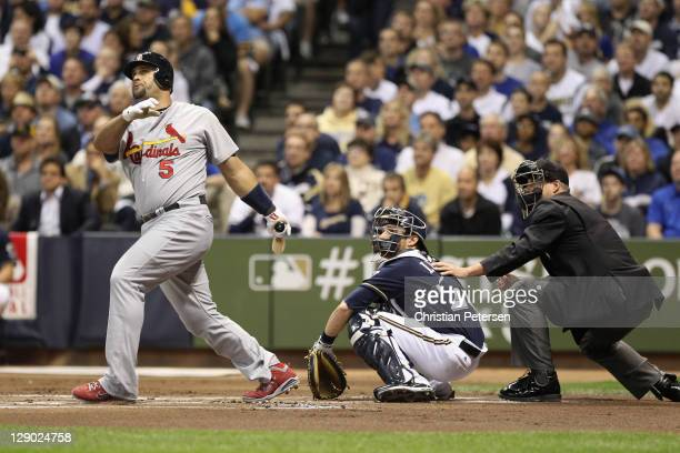 Albert Pujols of the St. Louis Cardinals hits a 2-run home run in the top of the first inning against the Milwaukee Brewers during Game Two of the...
