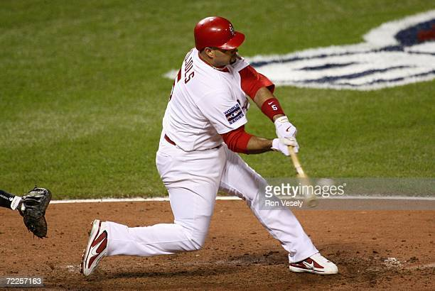 Albert Pujols of the St. Louis Cardinals hits a comebacker to pitcher Joel Zumaya of the Detroit Tigers in the seventh inning during Game Three of...