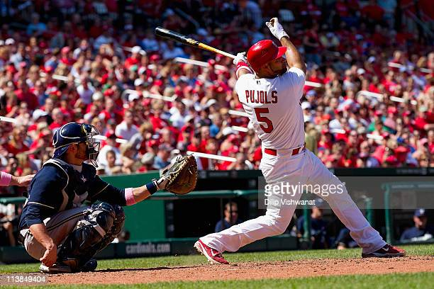 Albert Pujols of the St Louis Cardinals hits a double against the Milwaukee Brewers at Busch Stadium on May 8 2011 in St Louis Missouri