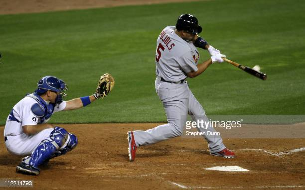 Albert Pujols of the St Louis Cardinals hits a home run in the fifth inning against the Los Angeles Dodgers on April 14 2011 at Dodger Stadium in Los...
