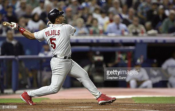 Albert Pujols of the St Louis Cardinals hits a homerun Tony Womack and Larry Walker scored 52 in the fourth inning over the Los Angeles Dodgers...