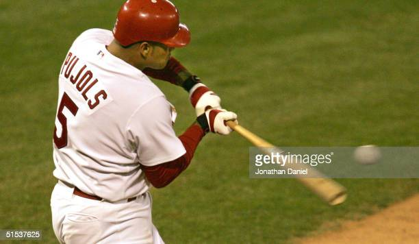Albert Pujols of the St Louis Cardinals hits a RBI double against the Houston Astros in the sixth inning of game seven of National League...