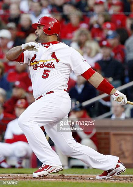Albert Pujols of the St Louis Cardinals hits a single against the Los Angeles Dodgers in the first inning of Game Three of the NLDS during the 2009...