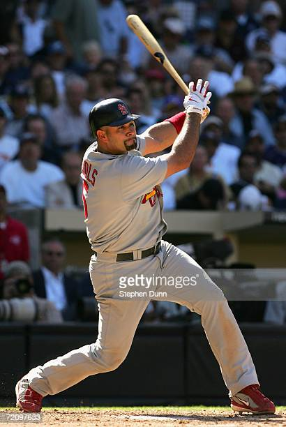Albert Pujols of the St Louis Cardinals hits a single against the San Diego Padres during the sixth inning of Game Two of the National League...