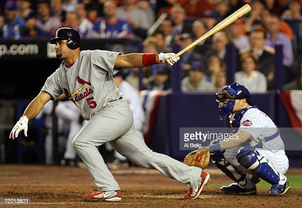Albert Pujols of the St Louis Cardinals hits a single in the eighth inning during game six of the NLCS against the New York Mets at Shea Stadium on...