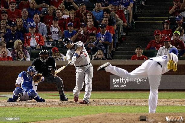 Albert Pujols of the St Louis Cardinals hits a solo home run in the ninth inning for his third home run of the night during Game Three of the MLB...