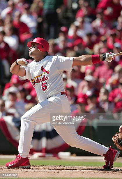 Albert Pujols of the St Louis Cardinals hits a solo home run in the first inning against the Los Angeles Dodgers in Game one of National League...