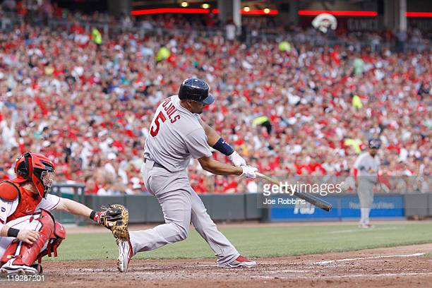 Albert Pujols of the St Louis Cardinals hits a threerun home run in the fifth inning against the Cincinnati Reds at Great American Ball Park on July...