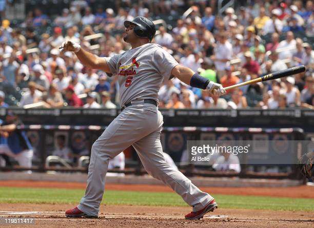 Albert Pujols of the St Louis Cardinals hits a two run home run against Jonathon Niese of the New York Mets in the first inning of their game on July...