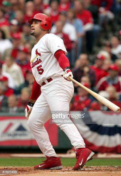 Albert Pujols of the St Louis Cardinals hits a tworun home run in the first inning of Game 6 of the National League Championship Series against the...