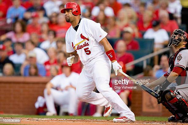 Albert Pujols of the St Louis Cardinals hits an RBI double against the Arizona Diamondbacks at Busch Stadium on June 28 2010 in St Louis Missouri