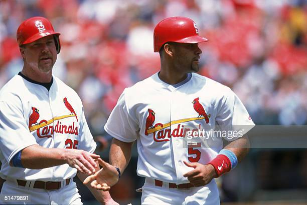 Albert Pujols of the St Louis Cardinals is congratulated by teammate Mark McGwire during the game against the Chicago White Sox at Busch Stadium on...