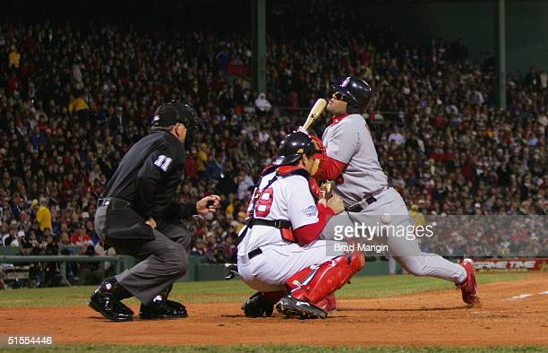 Albert Pujols of the St Louis Cardinals is hit by a pitch in the third inning of game one of the 2004 World Series game one against the Boston Red...
