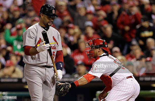 Albert Pujols of the St Louis Cardinals is tagged by Carlos Ruiz of the Philadelphia Phillies after a dropped third strike in the third inning of...