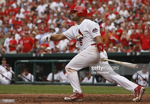 Albert Pujols of the St Louis Cardinals knocks in three runs against the Milwaukee Brewers at Busch Stadium July 29 2007 in St Louis Missouri The...