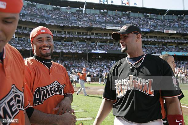 Albert Pujols of the St Louis Cardinals laughs with Johan Santana of the Minnesota Twins and Victor Martinez of the Cleveland Indians before the Home...