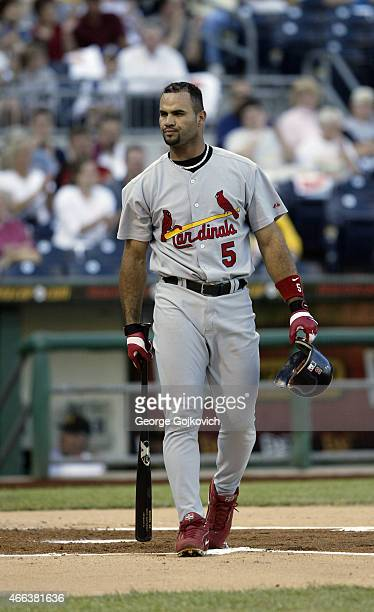 Albert Pujols of the St Louis Cardinals looks on from the field after batting against the Pittsburgh Pirates during a Major League Baseball game at...