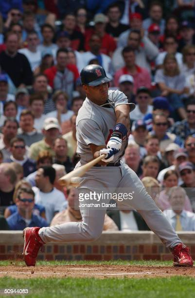 Albert Pujols of the St Louis Cardinals makes batonball contact during his atbat in the game against the Chicago Cubs on May 21 2004 at Wrigley Field...