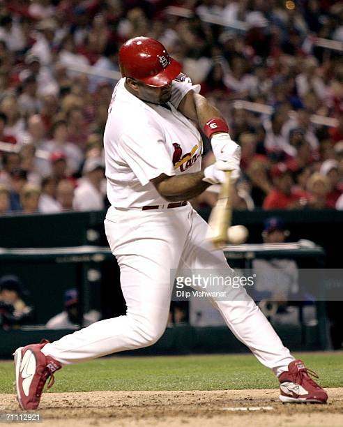 Albert Pujols of the St. Louis Cardinals makes contact for a base hit against the Chicago Cubs in the 6th inning at Busch Stadium on June 2, 2006 in...