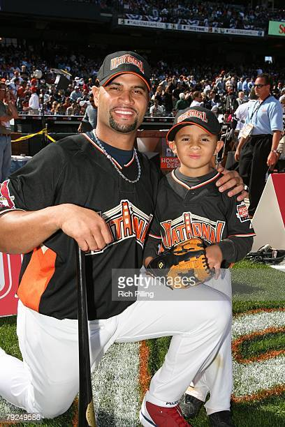 Albert Pujols of the St Louis Cardinals poses with son during the GATORADE AllStar Workout Day at ATT Park in San Francisco California on July 9 2007