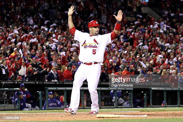 Albert Pujols of the St Louis Cardinals reacts after scoring a run in the bottom of the fourth inning against the Texas Rangers during Game One of...