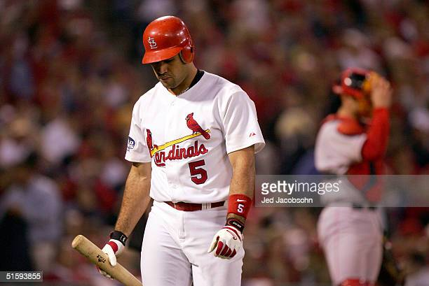 Albert Pujols of the St. Louis Cardinals reacts after striking out during the fourth inning of game four of the World Series against the Boston Red...