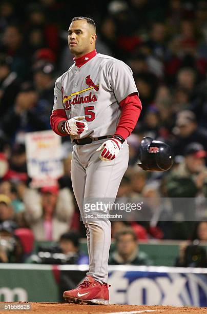 Albert Pujols of the St Louis Cardinals reacts after striking out to end the top of the sixth inning against the Boston Red Sox during game one of...