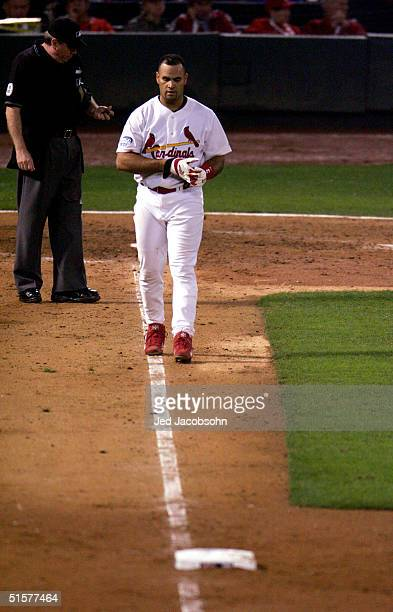 Albert Pujols of the St Louis Cardinals reacts after striking out to end the sixth inning against the Boston Red Sox during game three of the World...
