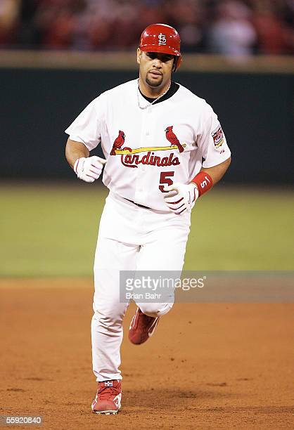 Albert Pujols of the St Louis Cardinals rounds the bases after hitting a solo home run in the sixth inning against the Houston Astros in Game Two of...