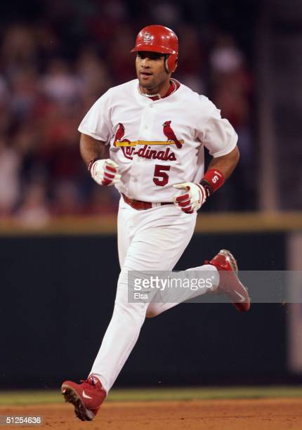 Albert Pujols of the St Louis Cardinals rounds the bases after his solo home run in the eigth inning against the San Diego Padres on September 1 2004...