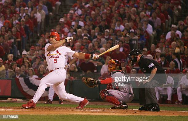 Albert Pujols of the St Louis Cardinals singles on a ground ball to third baseman Bill Mueller of the Boston Red Sox during the first inning of game...